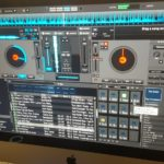 iMac with Turntable Mixer for playing at parties and Vertual DJ Setup